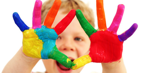 Image of child with painted hands
