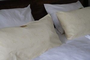 two cream pillows on a bed for adoptionhubuk website