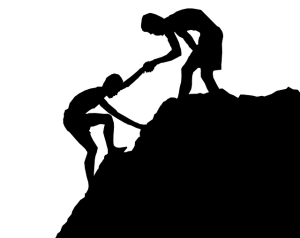 silouhette of man helping another man up a hill for adoptionhubuk website
