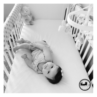 Favorite Black & White Baby Photo of 2015 Adorable baby girl in her crib in her nursery