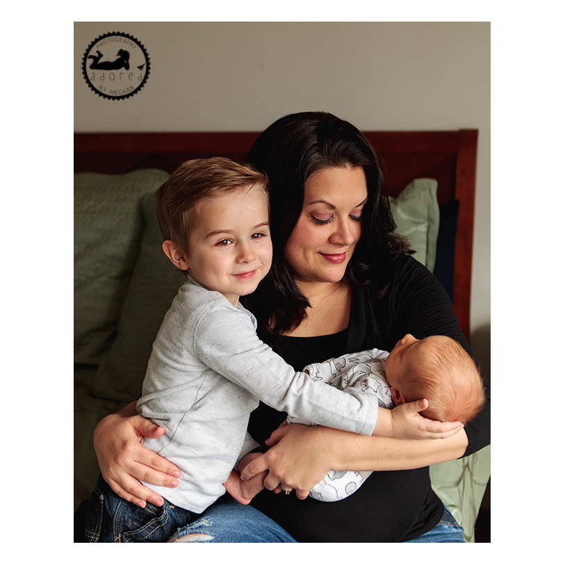 A Momma and her two boys during an in-home lifestyle newborn family portrait session.  Photographer Adored by Meghan. Richland, Wa.