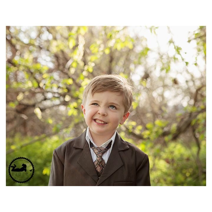 Little boy in jacket and tie making a silly face for his photos with Adored by Meghan