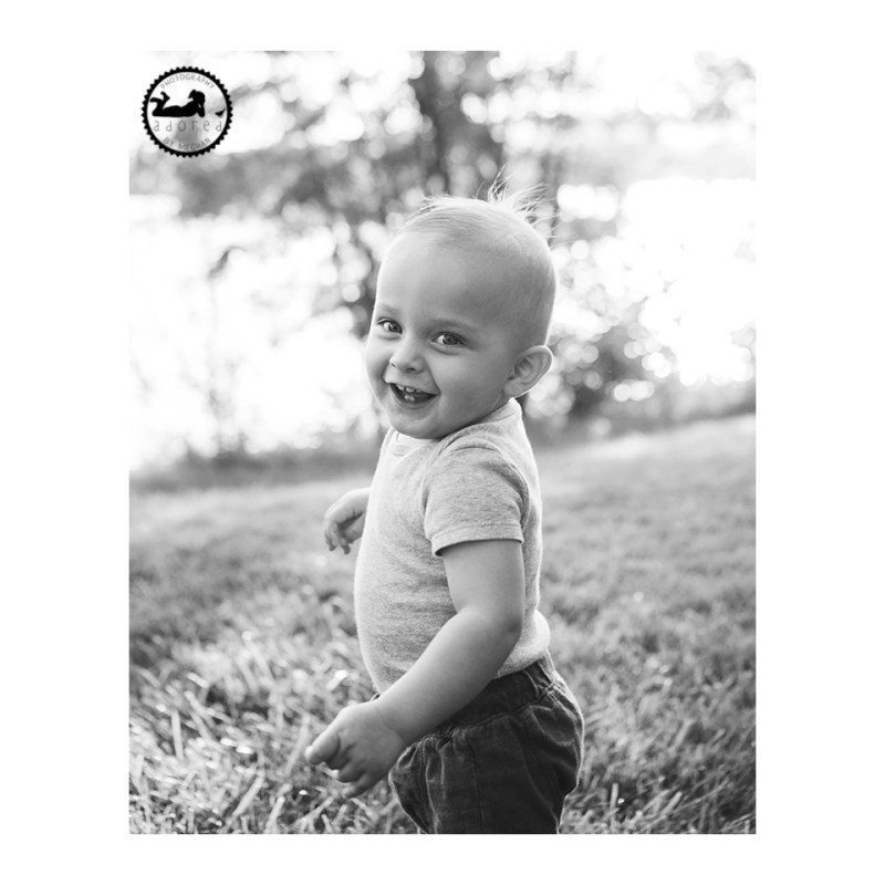 Adorable portrait of a 1 year old boy down by the river