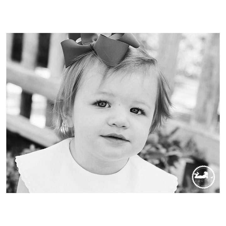 Black and White portrait of a Little girl in the garden during mini-session with Adored by Meghan