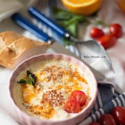Baked Eggs with Tomatoes, Parmesan and Cream
