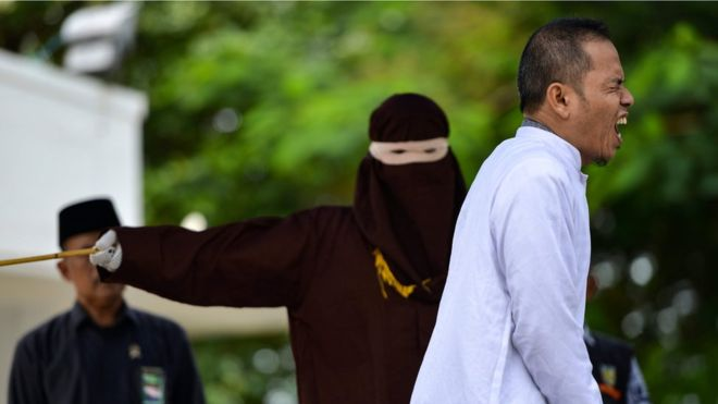 Indonesian man who helped set strict adultery laws flogged for adultery