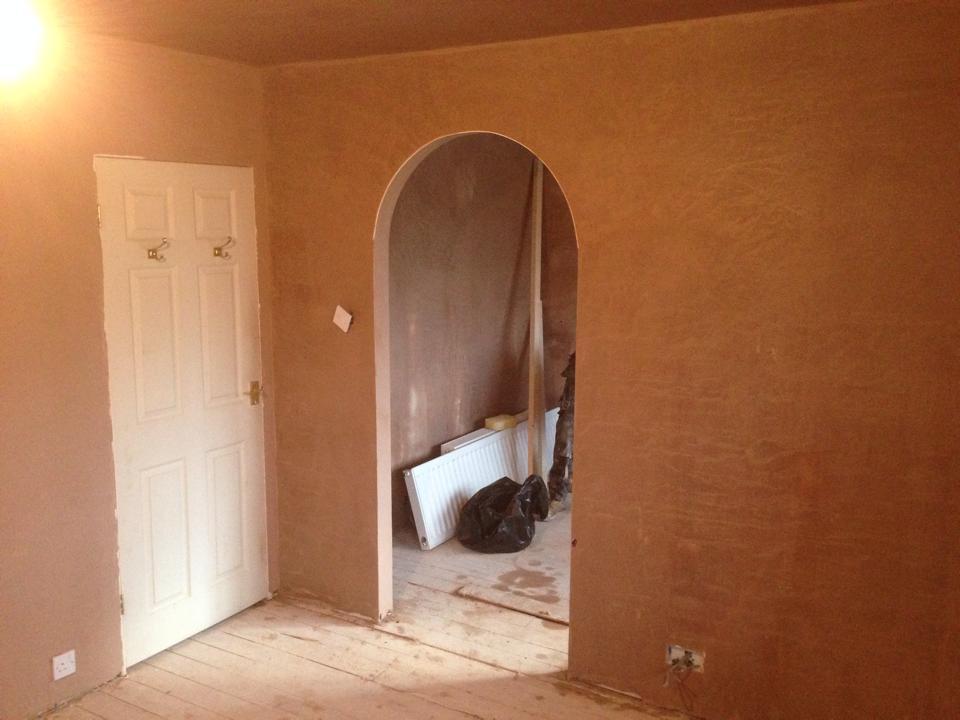 Freshly plastered arch, living room dining room