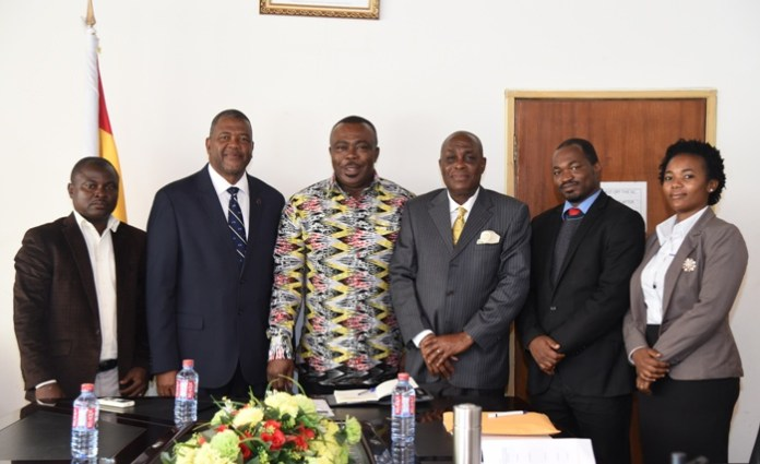 Mr Asamoah-Boateng (third left) with Dr Haldane Davies (second left), Mr Austin Gamey (third right) and other officials after the meeting