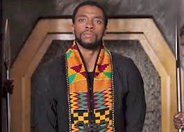 One of the movie characters in the kente costume