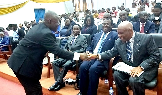 Lt Gen. Obed Akwa, Chief of the Defence Staff, Ghana Armed Forces (left), exchanging pleasantries with Justice Jones Dotse (right). Looking on are Apostle Professor Kwadwo Opoku Onyina (extreme left), former chairman of the Church of Pentecost and Dr. Emmanuel Hopeson (middle)