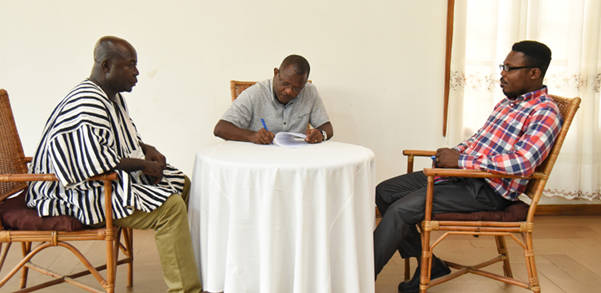 George Kporye (middle) siging the MoU with the local union executives
