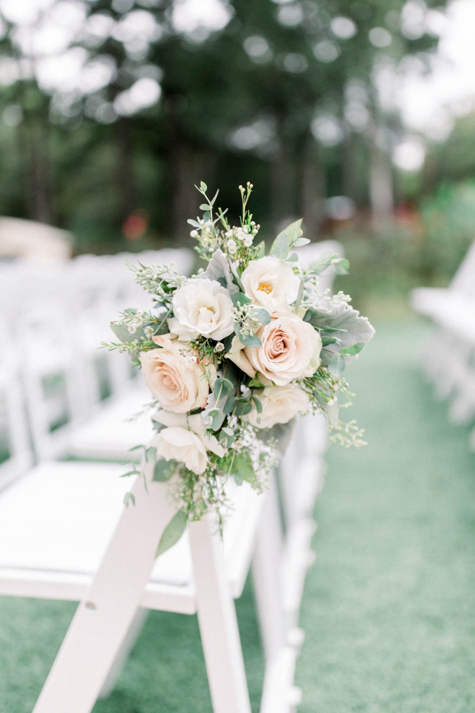 Wedding aisle flowers by Dallas florist Wild Rose Events, photographed by Dallas wedding photographer Adria Lea Photography