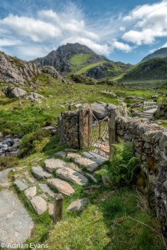 Decorative Iron Gate leading to the wooden Footbridge at the base of Llyn Idwal, Tryfan and the Devils Kitchen, snowdonia national park, north Wales,UK