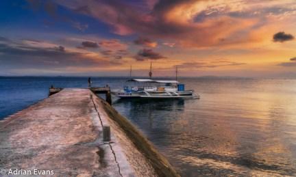 Tour boat sunset moored off Pandanon Island Bohol, Philippines