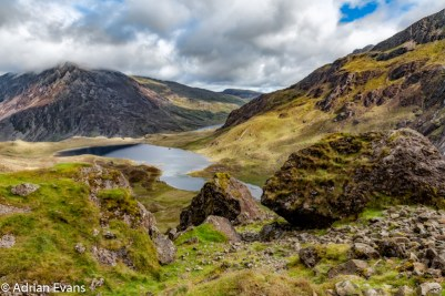 Llyn Idwal is a small lake that lies within Cwm Idwal in the Glyderau mountains of Snowdonia, North Wales UK