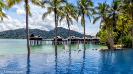 Swimming pool at the Pangkor Laut bay, off the West Coast of Malaysia along the Straits of Malacca, tropical isle with beautiful rain forests