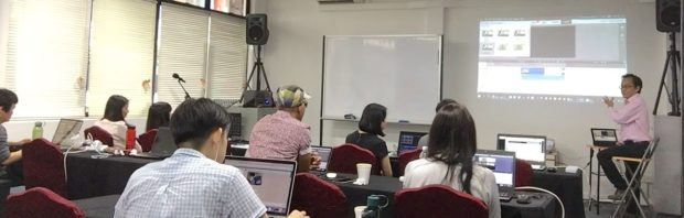 Adrian Lee teaching camera videography and video editing class in Singapore