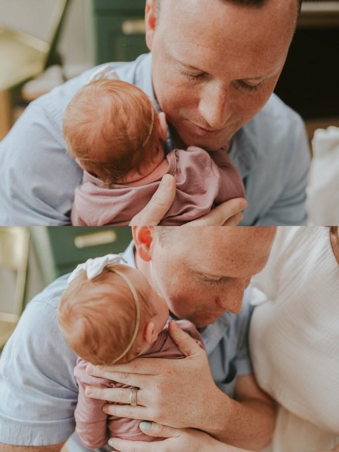 dad holding his newborn baby girl