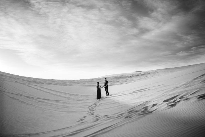Luis and Ale celebrating their love in the early morning at the Imperial Dunes in California | Chicago couples photographer