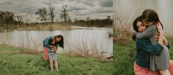 mom and daughter embrace near a lake in jackson par in chicago il