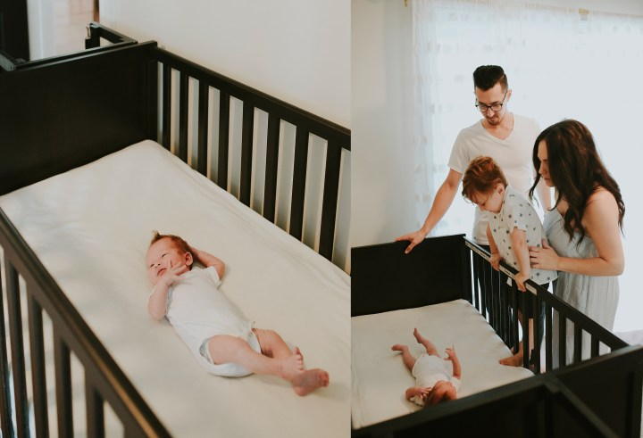 BABY IN CRIB AND FAMILY LOOKING IN ADORINGLY