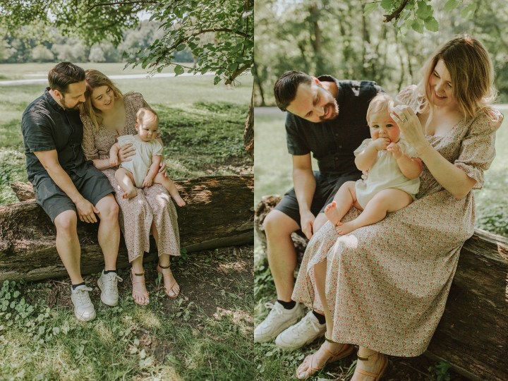 MOM DAD AND BABY SITTING ON A LOG