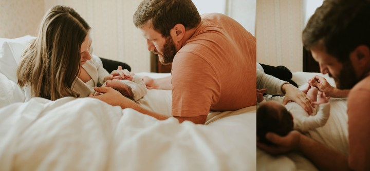 Mom and dad with baby on bed