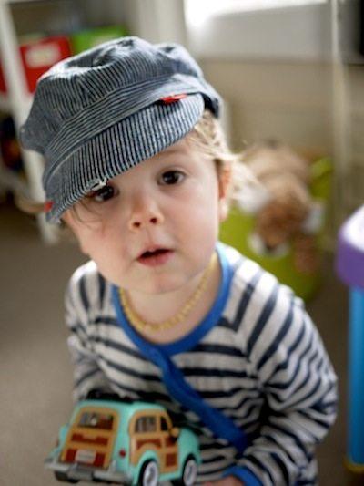 toddler wearing an amber teething necklace