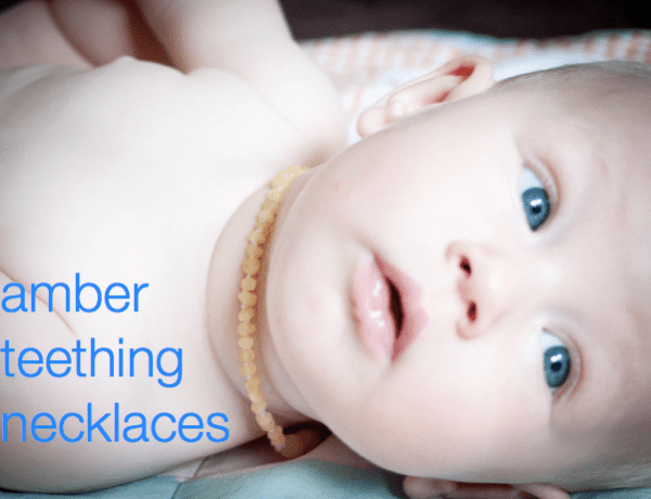 baby wearing amber teething necklace