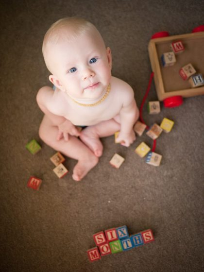 six month old baby and blocks