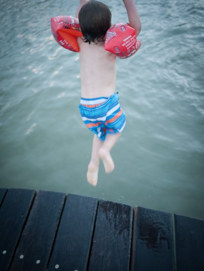 toddler jumping into the pool