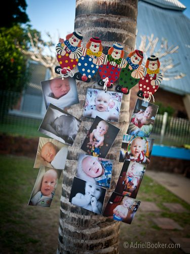 Judah's First Birthday Circus Party – photos of first year as decorations.