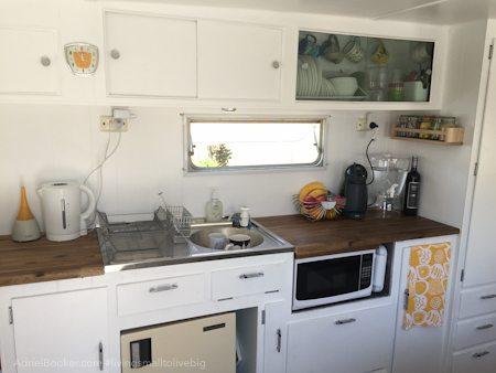 Adriel Booker - Living in a Caravan-Camper - kitchen area