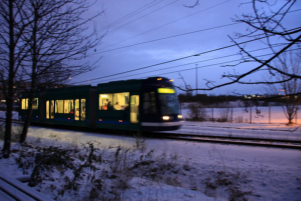 Streetcar heading to South Waterfront past where the new light rail & OHSU Building is going up.