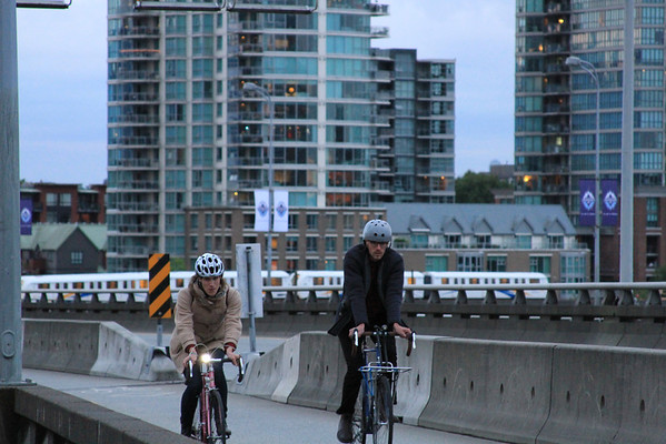 Skytrain & Cyclists on the Viaduct.