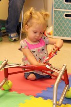 MacKenzie enjoys a treat after using her walker for the first time