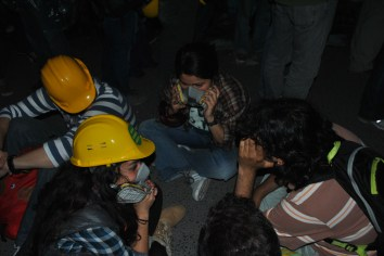 Protesters seat on Takism Sqaure early morning on June 13, 2013 with helmets and teargas masks.
