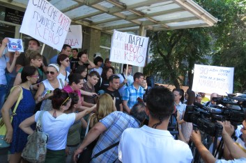 Journalists report on the protest against detention of a journalist Tomislav Kezarovski in front of the Preliminary Court in Skopje. /July 25, 2013/Photo by Aleksandra Dukovska