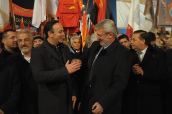Former director of the Department of Security and Counterintelligence Sasho Mijalkov greets Strasho Angelоvski, president of one of the first small political parties in Macedonia after independence in 1991.