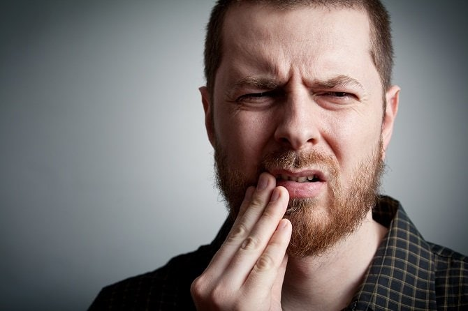 Toothache - man with teeth problems