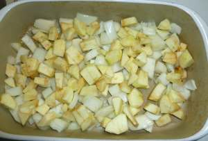 Apples and onions in roasting pan