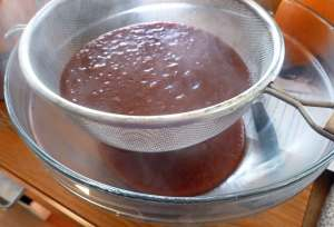 Straining Apple Cranberry Habanero Hot Sauce