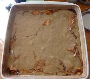 Second layer of batter over second layer of apples