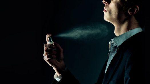 Business Man with Pheromone Spray