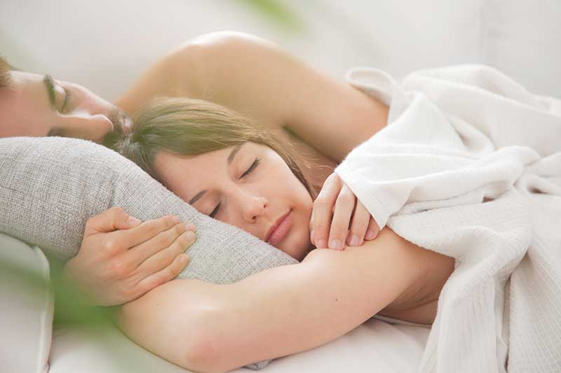 Man and Woman Couple Spooning Photo