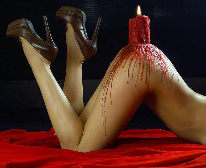 A Red Candle on Womans Bum Photo
