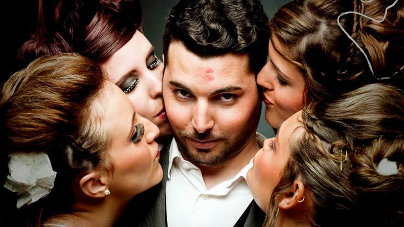 Man Being Kissed by Four Women