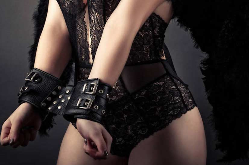Woman In Lacey Lingerie Wearing Wrist Restraints Photo