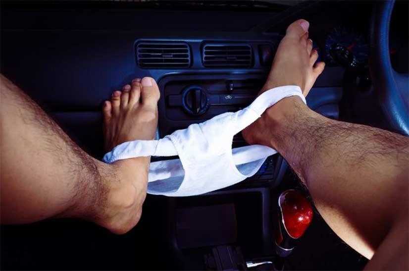 Hairy Legs Of Man In Car