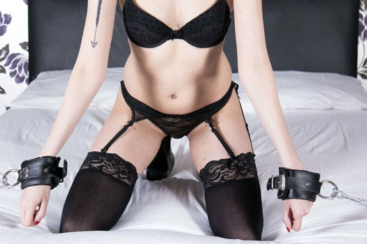 Woman On Bed Wearing Black Lingerie